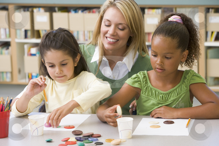 Kindergarten teacher sitting with students in art class,  stock photo,  by Monkey Business Images
