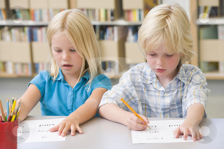 Kindergarten children learning to write stock photo,  by Monkey Business Images