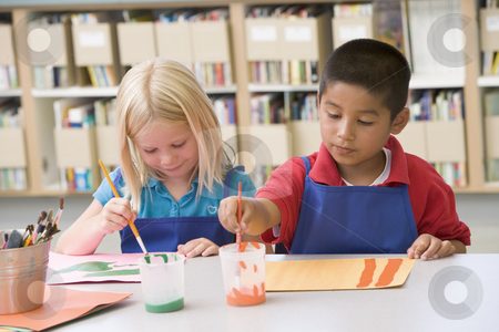 Kindergarten children painting stock photo,  by Monkey Business Images