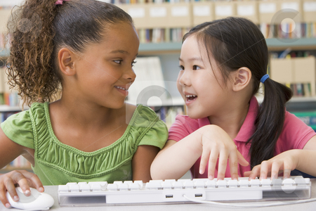 Kindergarten children using computer stock photo,  by Monkey Business Images