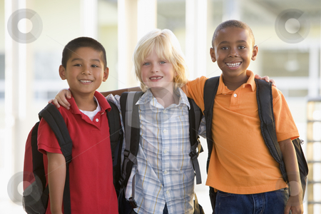 Three kindergarten boys standing together stock photo,  by Monkey Business Images