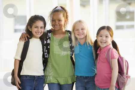 Three kindergarten girls standing together stock photo,  by Monkey Business Images