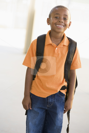 Portrait of kindergarten boy with backpack stock photo,  by Monkey Business Images
