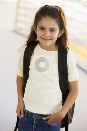 Portrait of kindergarten girl with backpack stock photo,  by Monkey Business Images