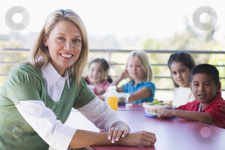 Kindergarten children eating lunch stock photo,  by Monkey Business Images
