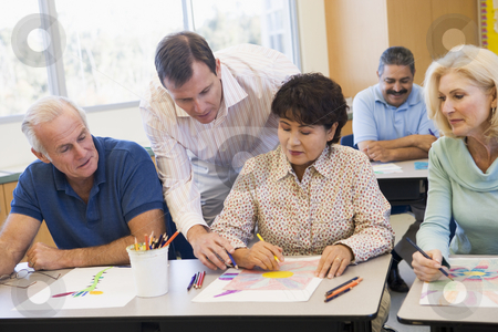 Mature students learning art skills stock photo,  by Monkey Business Images