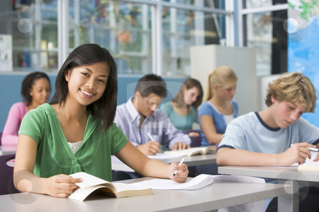 School children in high school class stock photo,  by Monkey Business Images