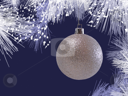 Silver Christmas Ornament stock photo, A silver Christmas ornament hanging from blue pine branches with twinkle lights and glitter. by Corinna Walby