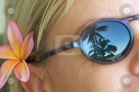 Tropical Relaxation stock photo, Woman Relaxing while Sunglasses Reflect Palm Trees and Shorline. by Andy Dean