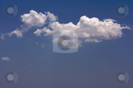 Puffy Clouds stock photo, Puffy Clouds on a blue sky. by Andy Dean
