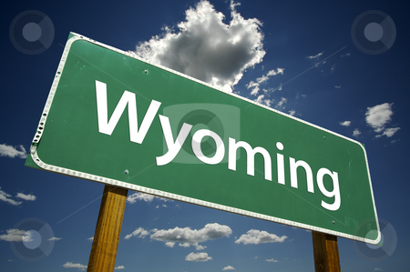 Wyoming Road Sign stock photo, Wyoming Road Sign with dramatic clouds and sky. by Andy Dean