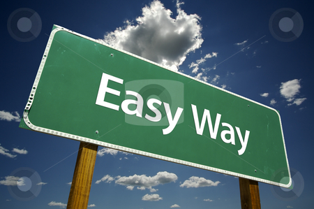 Easy Way Road Sign stock photo, Easy Way Road Sign with dramatic clouds and sky. by Andy Dean