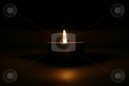 Candle stock photo, A lonely candle in the darkness by Fabio Alcini