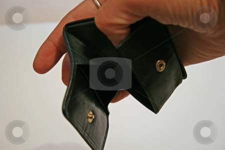 Empty wallet stock photo, A hand holding an empty black leather wallet by Fabio Alcini