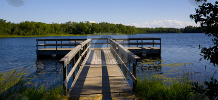 Fishing Pier in Blue Lake stock photo, A fishing pier in a blue lake in Northern Minnesota. by John McLaird