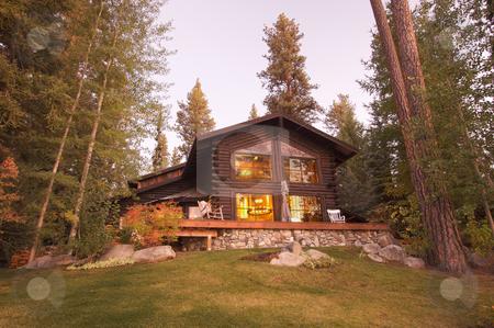 Beautiful Log Cabin Exterior stock photo, Beautiful Log Cabin Exterior Among Pine Trees by Andy Dean