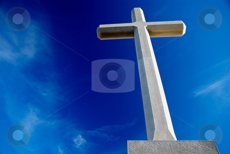 Christian cross  stock photo, Big Christian cross over blue sky and clouds by Milsi Art
