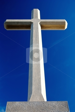 Christian cross  stock photo, Big Christian cross over blue sky by Milsi Art