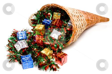 Cornucopia stock photo, A cornucopia filled with holday Christmas presents. by Robert Byron