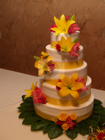 Wedding cake stock photo, Tiered wedding cake with yellow lilies by Cynthia Farmer
