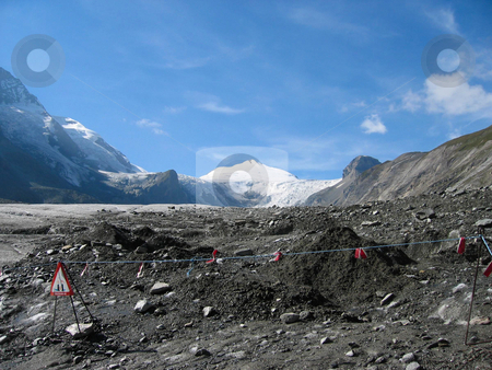 View on a glacier   stock photo, View on the glacier of the grossklockner with warning signs by Karin Claus