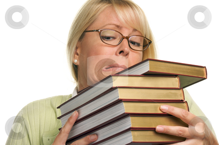 Attractive Student Struggles with Her Books stock photo, Attractive Student Struggles with Her Books Isolated on a White Background. by Andy Dean