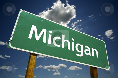 Michigan Road Sign stock photo, Michigan Road Sign with dramatic clouds and sky. by Andy Dean