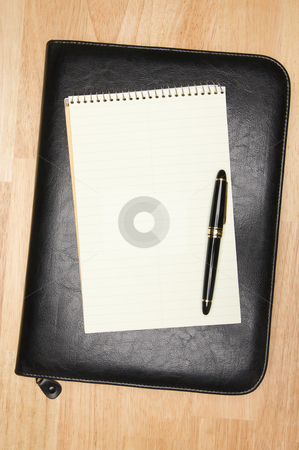 Pad of Paper, Pen & Binder stock photo, Pad of Paper, Pen & Leather Binder on a wooden background. by Andy Dean