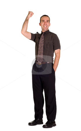 Fist Pumping stock photo, A young employee fist pumping the air with excitement by Richard Nelson