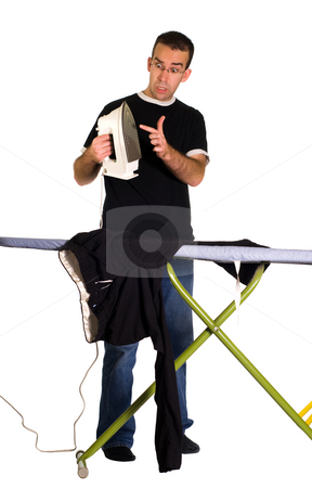 Hot Iron stock photo, A young man about to touch a hot iron, isolated against a white background by Richard Nelson