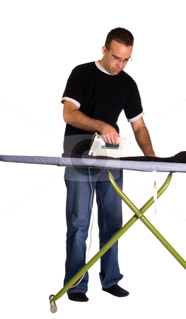Pressing Pants stock photo, A young man with an iron pressing a pair of pants, isolated against a white background by Richard Nelson