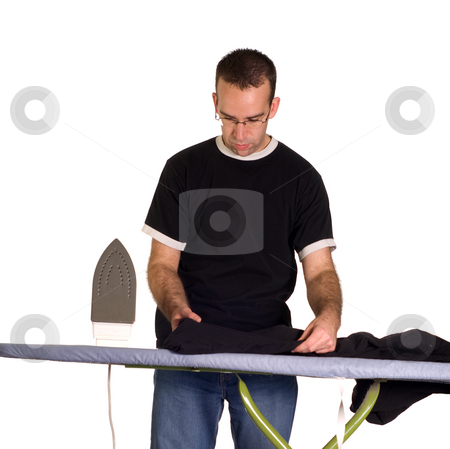Morning Work stock photo, A young man ironing his pants, isolated against a white background by Richard Nelson