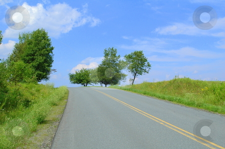 Into the unknown stock photo, Road going up a hill to the summit by Richard Sheehan