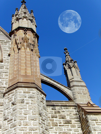 Spires and moon. stock photo, Two church spires and moon and sky background. by Claudia Ribeiro
