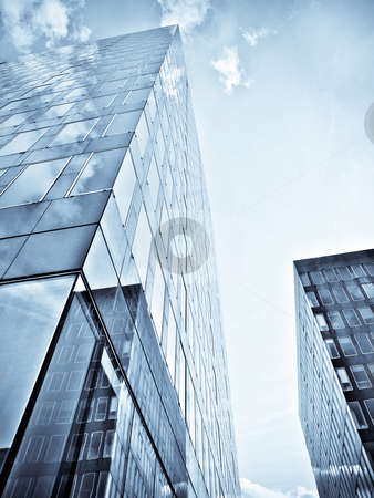 Blue office building stock photo, Blue office building with clouds reflection by Laurent Dambies
