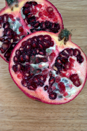 Opened stock photo, Sliced Pomegranate showing the seeds, on a chopping board by Paul Phillips