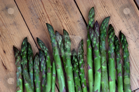 New harvest stock photo, Asparagus heads on a bench in the garden by Paul Phillips