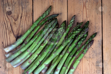 Freshly harvested stock photo, Group of freshly harvested asparagus on a garden bench by Paul Phillips