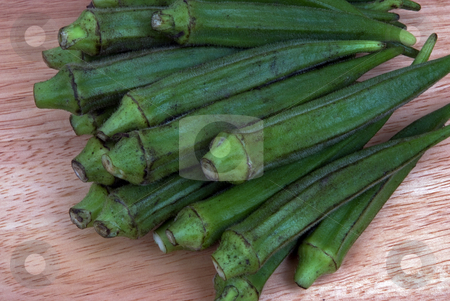Okra stock photo, A group of Okra on a cutting board by Paul Phillips
