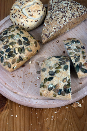 Multigrain stock photo, A group of multi-grain bread, on a chopping board by Paul Phillips