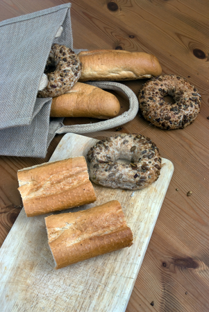 Variety stock photo, Fresh bread on a chopping board with natural bag by Paul Phillips