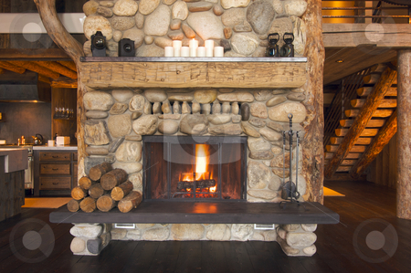 Rustic Fireplace stock photo, Rustic Fireplace in Log Cabin by Andy Dean