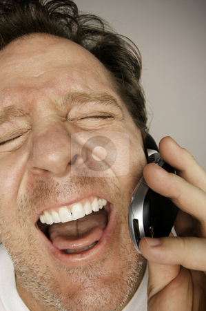 Ecstatically Happy Man on Cell Phone stock photo, Ecstatically Happy Laughing Man on Cell Phone. by Andy Dean