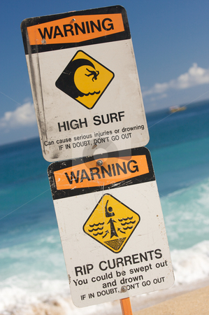 Surf and Currents Warning Sign stock photo, Surf and Currents Warning Sign on a beach in Hawaii by Andy Dean