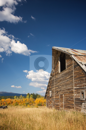 Rustic Barn Scene stock photo, Rustic Barn Scene with Deep Blue Sky and Clouds by Andy Dean