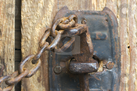 Rusty Barn Door Latch and Chain stock photo, Antique Rusty Barn Door Latch and Chain by Andy Dean