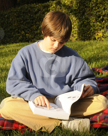 Teenager Studying stock photo, Young teenager studying his homework by Timothy OLeary