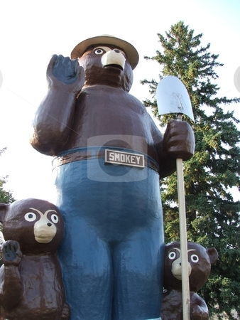 Prevent Forest Fires stock photo, This 26' tall Smokey the Bear statue with two bear cubs in International Falls, MN is a testament to the heavily forested logging area on the United State's northern border.  International Falls lays claim to being the coldest spot in the nation. by Dennis Thomsen