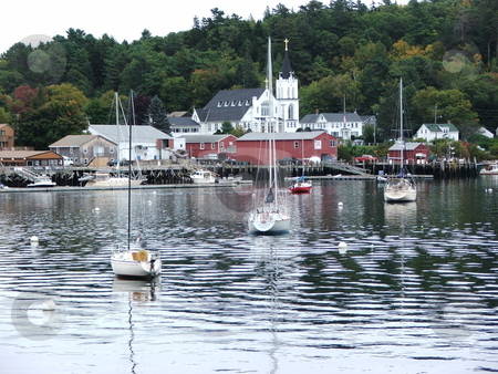 Boothbay Harbor, Maine stock photo, Boothbay Harbor is a favorite Maine yachting destination in the summer months and hordes of tourists descend on this popular fishing village.  Yearound it is a scenic seaport as portrayed here in this fall image. by Dennis Thomsen