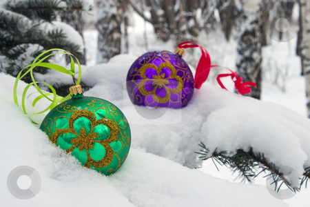 Christmas time. stock photo, Two color christmas baubles sitting in a bed of snow. by Yury Ponomarev
